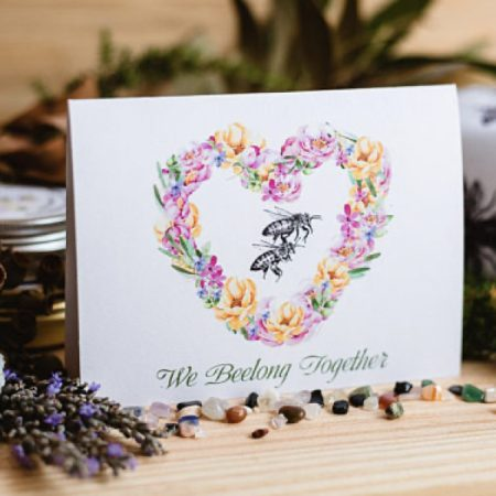 Blank card with bee in a floral wreath
