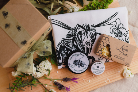 Beautifully presented care package with a Bee Tea Towel, Hard working Hands Balm, Beeswax Soap and Lip Balm