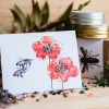 card with a bee and two red poppies